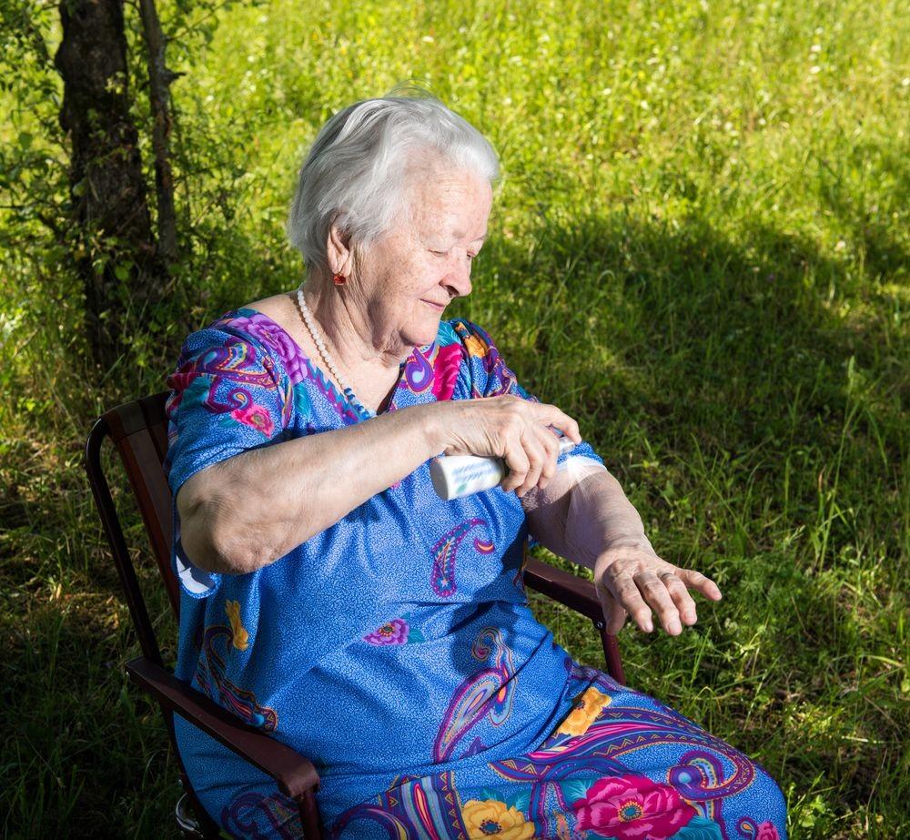 grandma-spraying-repellant